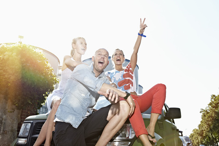 Germany,Cologne,Man And Women Sitting On Car