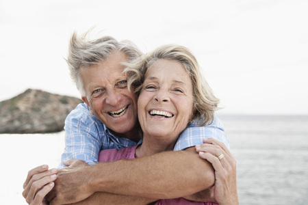 looking for love: Spain,Senior Couple Embracing At Harbour,Smiling LANG_EVOIMAGES