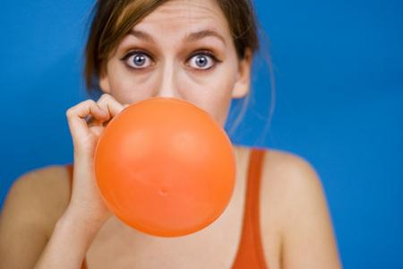 devote: Woman Blowing Up Baloon