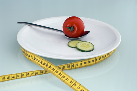 Tomato And Cucumber Slice On Plate With Measuring Tape LANG_EVOIMAGES