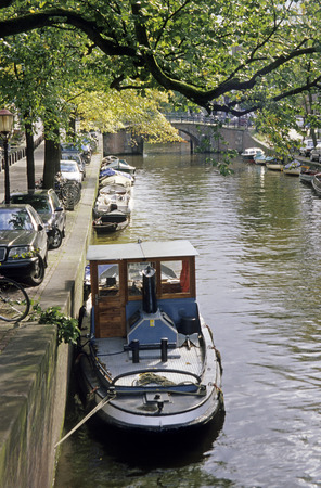Canal With Boats In Amsterdam, Netherlands