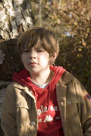 Boy Leaning On Tree, Portrait