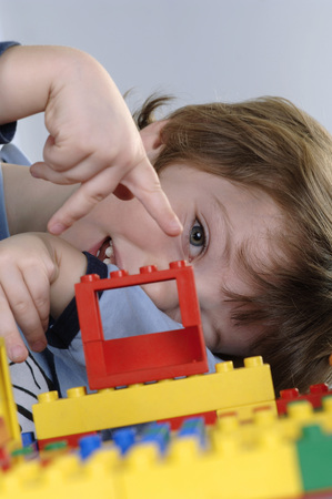Boy Playing With Lego Bricks LANG_EVOIMAGES