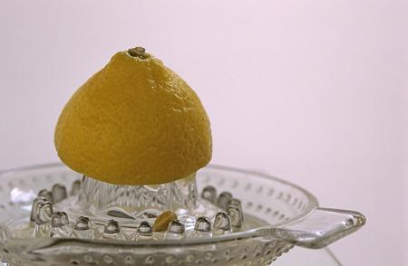 citrons: Close-Up Of Lemon Half On Juicer
