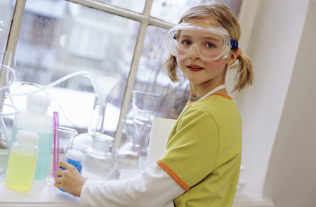 enquiring: Girl (8-9) In Chemical Lab Wearing Protective Goggles, Portrait LANG_EVOIMAGES