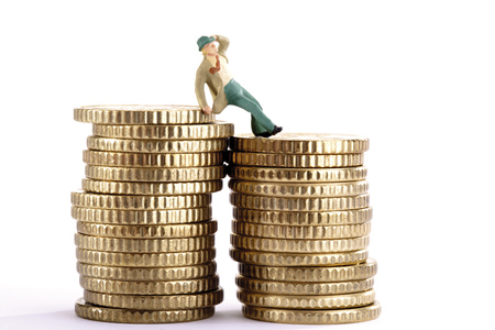 Figurine Leaning On Pile Of Coins, Holding Hat