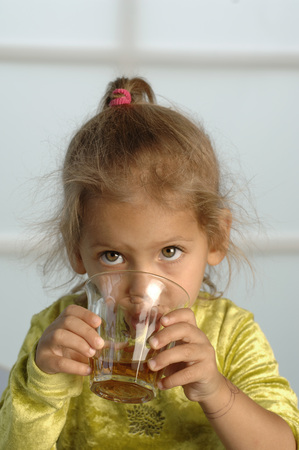 critical thinking: Girl (2-3) Drinking Juice, Close-Up