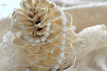 trashy: Christmas Decoration With Fir Cone And Pearl String, Close-Up