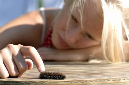 Girl Playing With Caterpillar
