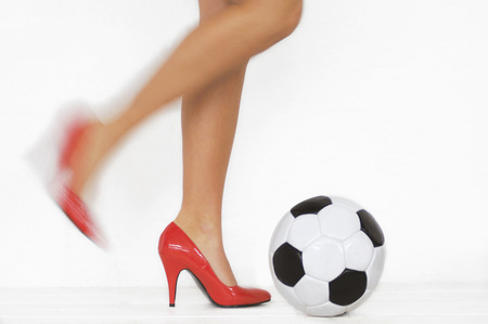 Woman With Red High Heels Kicking A Soccer Ball, Detail