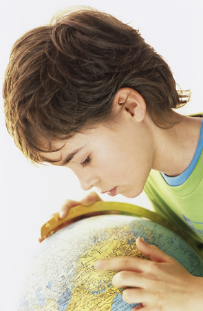 enquiring: Boy (10-11) Looking At Globe, Elevated View, Close-Up