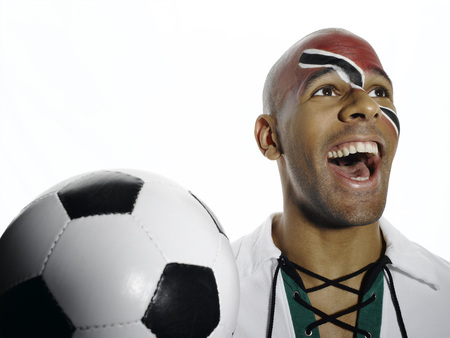 jubilating: Football Fan With Trinidad And Tobago Flag Painted On His Face LANG_EVOIMAGES
