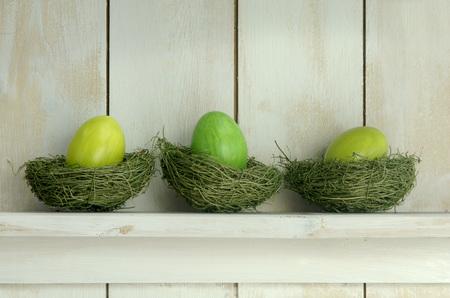 Green Easter Eggs Lying On Shelf On Grass LANG_EVOIMAGES