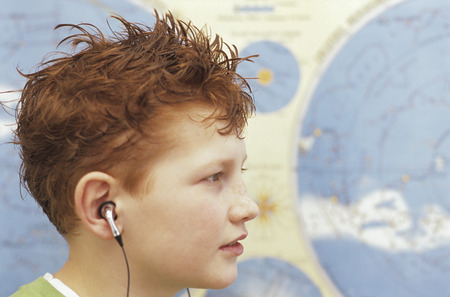 enquiring: Boy (10-11) Wearing Headphones, Close-Up, Side View