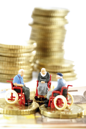 Figurines In Wheelchairs On Coins