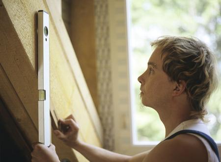 Carpenter Using Level Tool