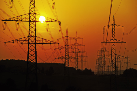 generic location: Electricity Pylons And Power Lines, At Sunset LANG_EVOIMAGES