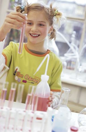enquiring: Girl (8-9) Holding Test Tube In Chemical Lab, Smiling
