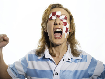 jubilating: Football Fan With Croatian Flag Painted On Face