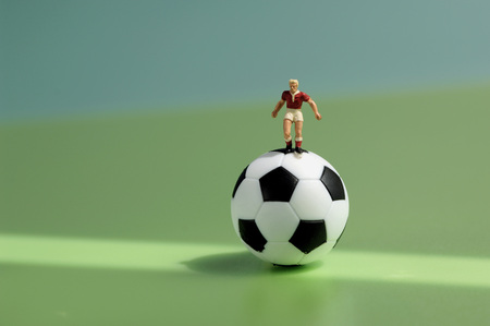 Toy Figurine On Football LANG_EVOIMAGES