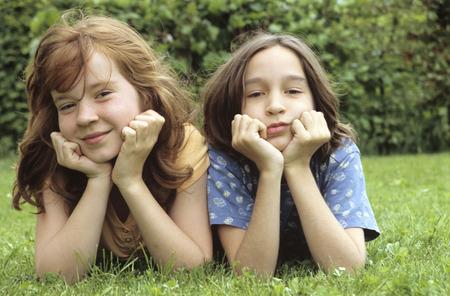 in low spirits: Children Lying In Meadow In Garden,Portrait