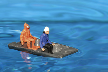 Two Figurines In Boat, Close-Up LANG_EVOIMAGES