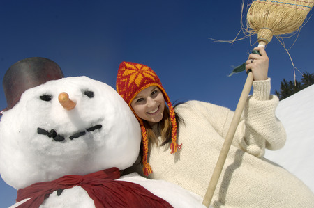 Woman Leaning At Snow Man, Portrait