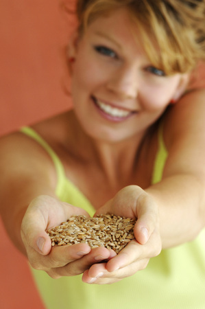 Young Woman Holding Grains, Close-Up