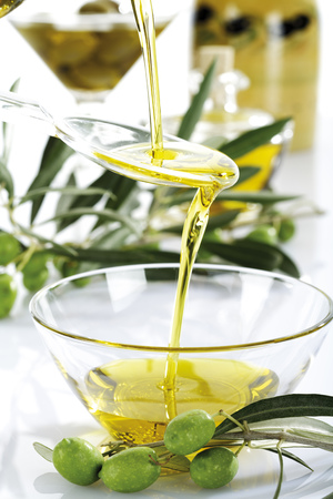 Fresh Green Olives And Olive Oil In Glass Bowl