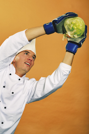 Chef Holding Cabbage, Low Angle View LANG_EVOIMAGES