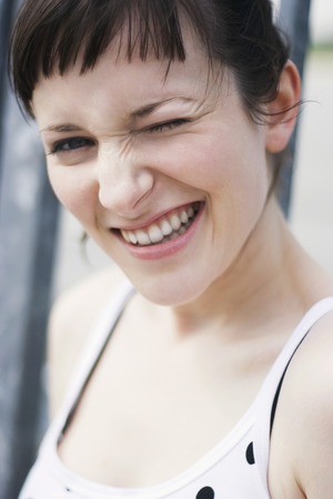 Young Woman Winking Eye,Close-Up,Portrait