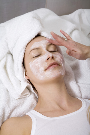 Cosmetician Applying Face Mask To Young WomanS Face, Elevated View