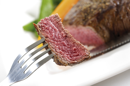 Piece Of Beef Filet On Fork,Elevated View