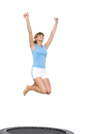 in low spirits: Young Woman Jumping On Trampoline,Low Angle View LANG_EVOIMAGES