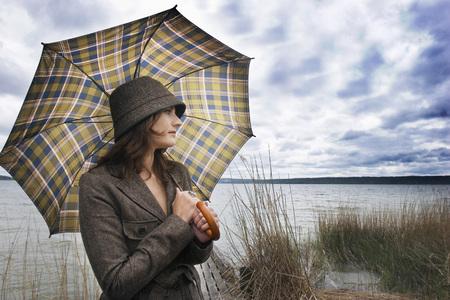Young Woman Holding Umbrella,Looking Away,Close-Up