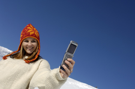 Young Woman With Mobile Phone, Wearing Cap
