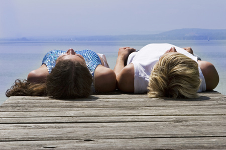 Young Couple Lying On Jetty