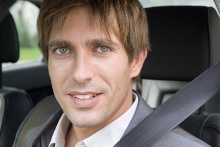 Young Man Sitting In Car, Portrait LANG_EVOIMAGES