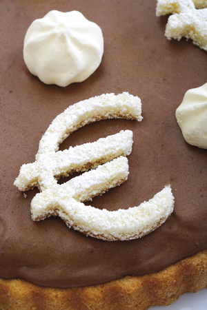 sweetly: Chocolate Sponge Cake With Euro Sign, Elevated View, Close-Up LANG_EVOIMAGES