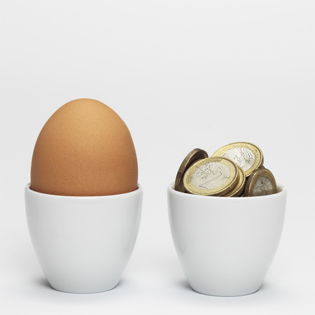 Egg And Euro Coins In Egg Cups,Close-Up
