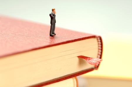 Man Standing On Book, Thinking, Figurine