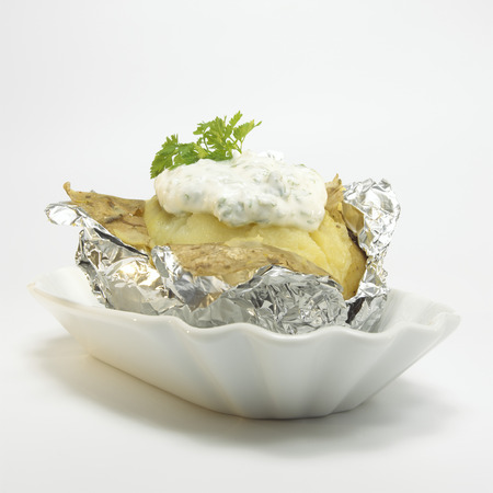 Baked Potato With Curd Cheese In Foil, Close-Up LANG_EVOIMAGES