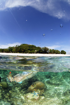 Philippines,Dalmakya Island,Woman Snorkelling In Sea,Underwater View LANG_EVOIMAGES