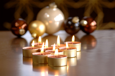 christmas baubles and burning tea lights stock photo 89794884