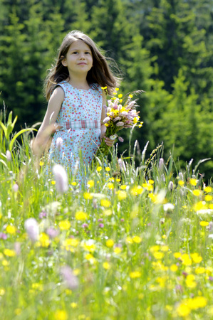 Girl With Bunch Of Flowers In Summer Meadow