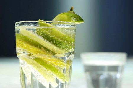 citrons: Lemon And Lome Slices In Glass Of Water, Close-Up
