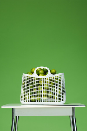 citrons: Limes In Bag On Table