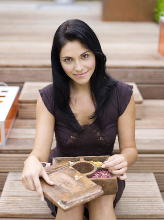 Woman Holding Box Containing Spice