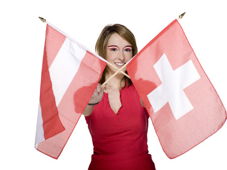 Woman Crossing Austrian And Swiss Flag, Portrait, Smiling LANG_EVOIMAGES
