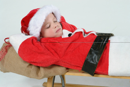 Boy (7-9) Wearing Christmas Outfit, Eyes Closed, Close-Up